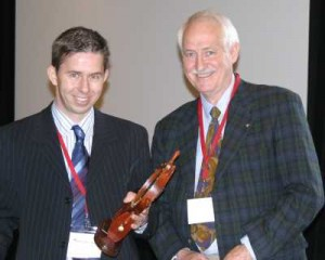 Dr. Robert Baird (R.) presents the Dr. Charles H. Miller Award for 2007 to Dr. Pierre-Jean Arnoux (L.)